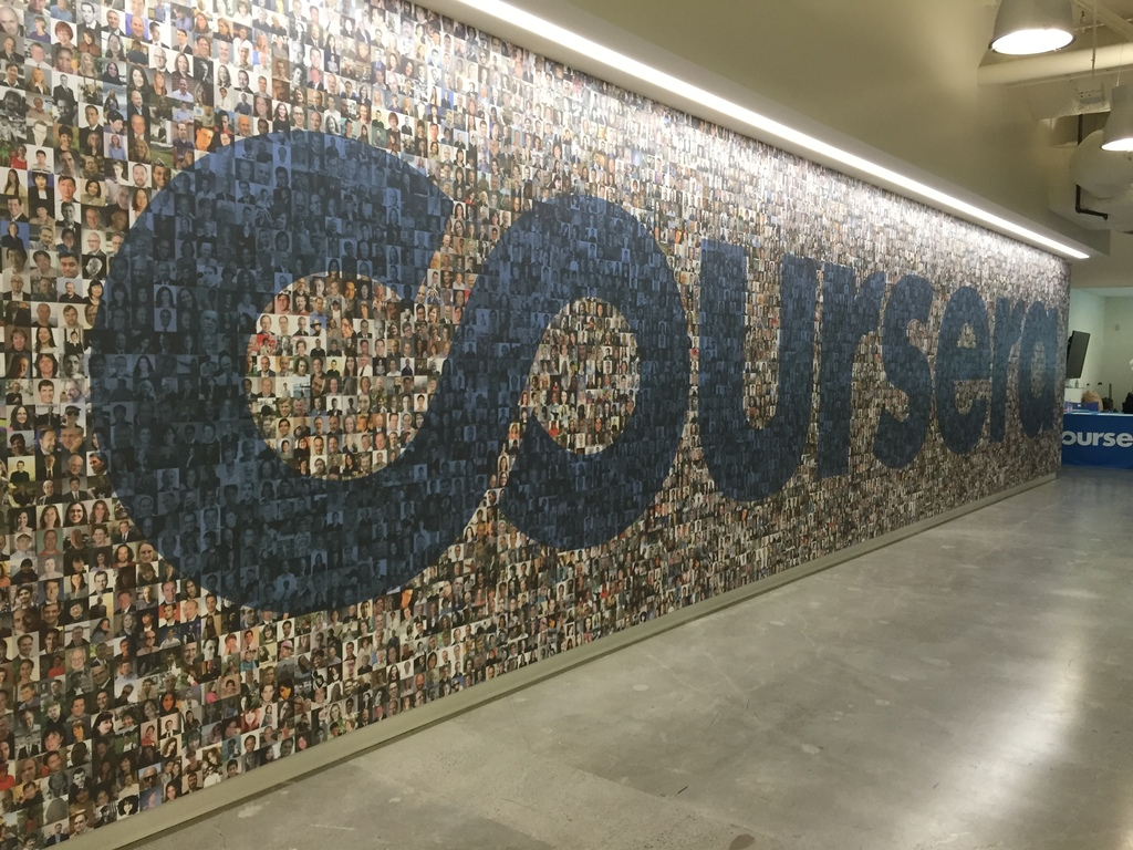 """Coursera"" in large letters on a mosaic-looking wall."