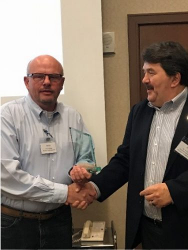 Mark Halsey, 2016 Recipient of the J.0. Grantham Leadership Award presents the 2017 award to Gerald Rhead from Michigan State University.
