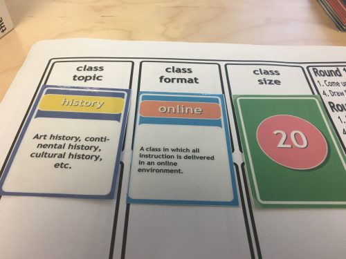 The game starts with three randomly-assign cards dictating class topic, format, and size. For this play through, the player was assigned to a history class being taught online to a class of 20 students.