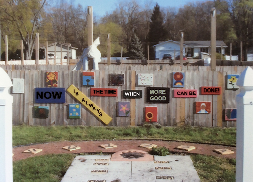 "Image of a mural in a garden that reads ""Now is always the time when more good can be done!"""